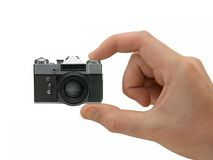 Super compact camera in hand Stock Photos