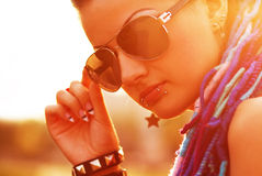 Super cool punk girl at sunset. One of the coolest posing at sunset Stock Photography