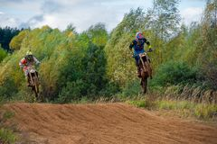 Super country-cross. SERPUKHOV, RUSSIA - OCTOBER 7, 2017:  An unidentified riders, Class MXL - 2 cross-country, in the 4 stage  MX series, the Red Wings Cup 2017 Stock Image