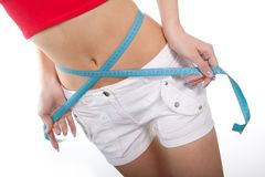 Super diet. The young girl measures waist volume Royalty Free Stock Photo