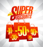 Super discounts advertising design. With red paper shopping bags, sale concept Royalty Free Stock Photo