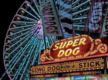 Super Dog Hot Dog Food Stall in Front of Ferris Wheel during Nighttime Stock Photography