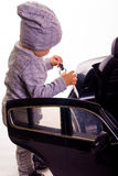 Super driver - little boy playing with big black toy car Royalty Free Stock Image