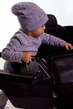 Super driver - little boy playing with big black toy car Royalty Free Stock Photo