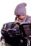 Super driver - little boy playing with big black toy car Stock Photo