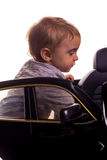 Super driver - little boy playing with big black toy car Stock Photos