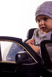 Super driver - little boy playing with big black toy car Royalty Free Stock Images