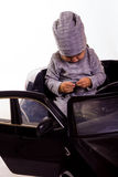 Super driver - little boy playing with big black toy car Stock Images