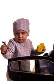 Super driver - little boy playing with big black toy car Royalty Free Stock Photos