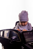 Super driver - little boy playing with big black toy car Stock Photography