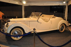 Super elegant completely white old-timer car. Old-timer completely white interior and white external color and white wheels of cabriolet coupe elegant Royalty Free Stock Image