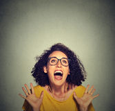 Super excited funky girl looking up Stock Images
