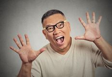 Super excited funky guy with glasses looking at you arms raised at camera Royalty Free Stock Photography