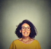 Super excited happy girl in glasses looking up Stock Photos
