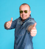 Super excited young man gesturing thumbs up Stock Image
