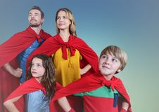 Super family wearing red cape standing with hand on hip against clear sky background. Composite image of super family wearing red cape standing with hand on hip Stock Photography