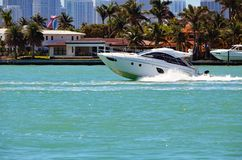 Super Fast Cabin Cruiser on the Florida Intra-Coastal. Superfast cabin cruiser speeding on the florida intra-coastal waterway off Miami Beach Royalty Free Stock Photography