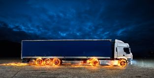Super fast delivery of package service with a truck with wheels on fire. Super fast delivery of package service . A truck with wheels on fire on the road stock photography