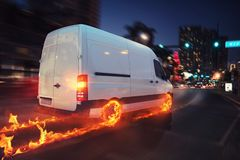 Super fast delivery of package service with van with wheels on fire. 3D Rendering. Moving truck on a city road with skyscrapers background. 3D Rendering stock images