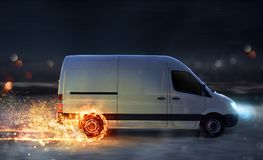 Super fast delivery of package service with van with wheels on fire. Super fast delivery of package service . van with wheels on fire on the road Royalty Free Stock Photo