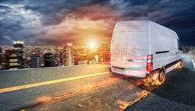 Super fast delivery of package service with van with wheels on fire. Super fast delivery of package service. Van with wheels on fire on the road royalty free stock photos