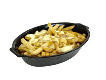 Super fatty fries with cheese in sauce (poutine). Super fathy fries with cheese in sauce on white background Stock Image