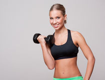 Super fit blond woman. Royalty Free Stock Photography