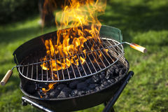 Super flames on the grill Royalty Free Stock Photo