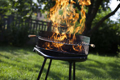 Super flames on the grill Stock Photography