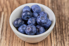 Super food bilberries in a white cup Royalty Free Stock Image