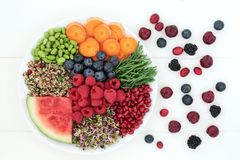 Super Food for Fitness. Concept with berry fruit, samphire, carrots, quinoa salad, sprouting seeds with health foods high in antioxidants, protein, anthocyanins royalty free stock image