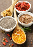 Super food - goji berries, chia seeds, flax seeds, walnuts and omega-3 Stock Photos