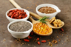 Super food - goji berries, chia seeds, flax seeds, walnuts and omega-3 Royalty Free Stock Image