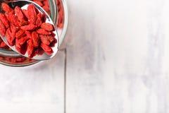 Super food goji berries in a metal spoon. Royalty Free Stock Images