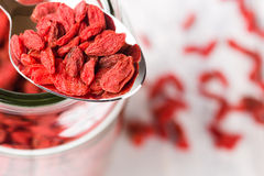 Super food goji berries in a metal spoon on a full jar. Stock Image