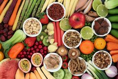 Super Food for Good Health. Concept with fresh fruit and vegetables and chinese herbal medicine selection with foods high in anthocyanins, antioxidants stock photos