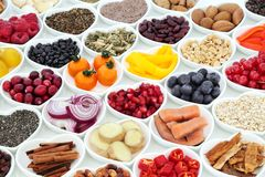 Super Food for a Healthy Heart. Super food nutrition for a healthy heart with fresh fruit, vegetables, fish, cereals, seeds, nuts. spice and herbal medicine stock images