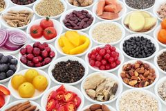 Super Food Nutrition for a Healthy Heart. High in antioxidants, anthocyanins, fiber, vitamins and minerals with fresh fruit, vegetables, pulses, seeds, nuts stock photos