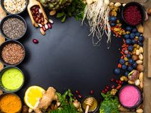 Free Super Food Or Vegetarian Food Concept. Seeds, Cereals, Beans, Vegetables, Herbs For Healthy Cooking On Black Wooden Background Stock Image - 144885051