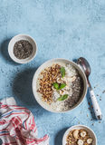Super food smoothie bowl. Healthy Breakfast. On a blue background, top view stock image