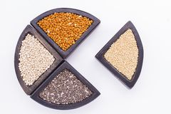 Super food. In wooden containers, amaranth, chia, quinoa and red millet stock image