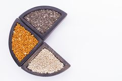Super food. In wooden containers, amaranth, chia, quinoa and red millet stock photo