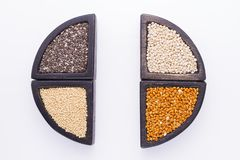 Super food. In wooden containers, amaranth, chia, quinoa and red millet royalty free stock images