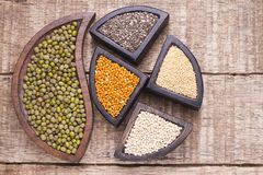 Super food. In wooden containers, amaranth, chia, quinoa and red millet royalty free stock photography