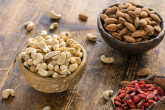 Super foods: cashews, almonds and goji berries Royalty Free Stock Photo