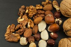 Super foods for human brain. Nuts on a wooden table. Royalty Free Stock Photography
