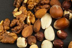 Super foods for human brain. Nuts on a wooden table. Stock Photos