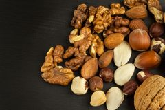 Super foods for human brain. Nuts on a wooden table. Royalty Free Stock Photos