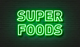 Super foods neon sign on brick wall background. Super foods neon sign on brick wall background royalty free stock images