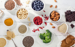 Super foods on a white wooden background. Flat lay royalty free stock images